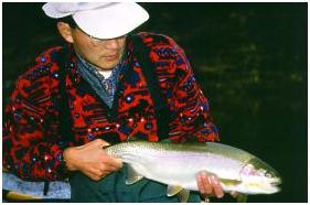 Brian with a healthy Kamloops Rainbow trout!